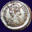 A coin with the image of the Emperor Theodosius II (c)1999 Princeton Economic Institute