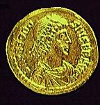 A coin with the image of the Emperor Theodosius I (c)1998 Princeton Economic Institute